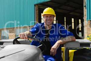 Smiling worker sitting in tractor