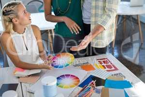 Executives looking at color shade swatch