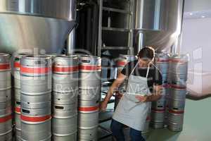 Worker counting kegs