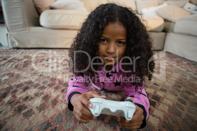 Girl playing video game in the living room at home