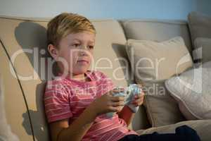 Boy playing video game in the living room