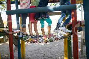 Children walking on jungle gym at play ground