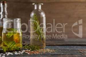 Spice by herb with oil in container