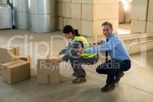 Manager motivating female worker while working