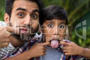 Portrait of father and son teasing