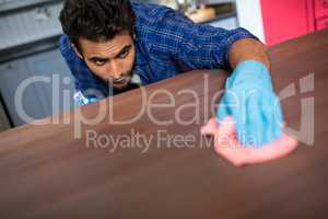 Man cleaning table with napkin