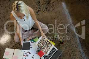 High angle view of businesswoman holding document at office