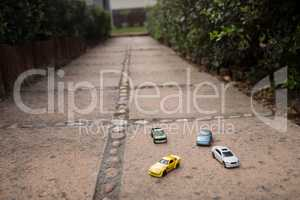 Close up of toy cars on footpath