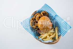 Burger and French fries with onion rings