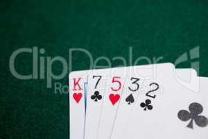 Playing cards arranged on poker table