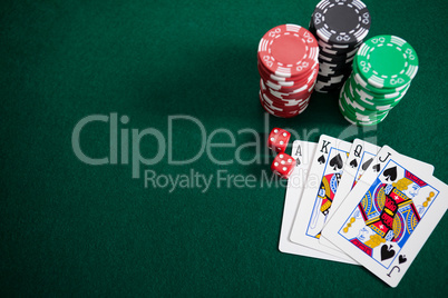 Playing cards, dices and casino chips on poker table