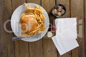 Snacks and cold drink on wooden table
