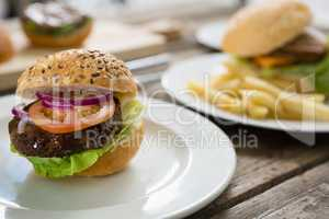Close up of hamburger in plate on table