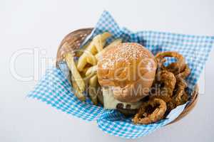 High angle view burger and French fries with onion rings