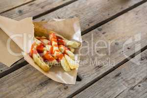High angle view of French fries with sauce