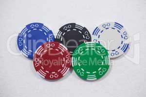Casino chips arranged on white background