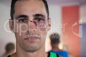 Close-up portrait of male boxer with nose injury