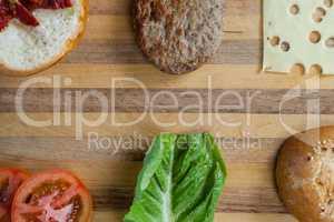 Sliced vegetables ingredient for making hamburger on chopping board