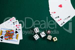 Playing cards and dices on poker table