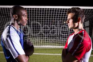 Side view of young male soccer players looking at each other