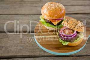 High angle view of burgers on cutting board