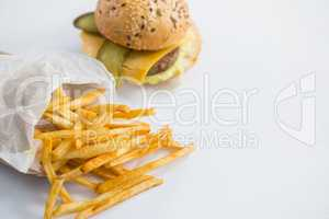 High angle view of French fries by burger
