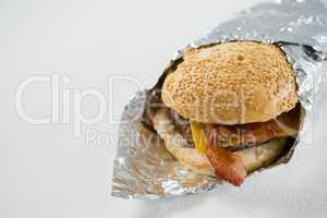 Close up of burger wrapped in foil paper