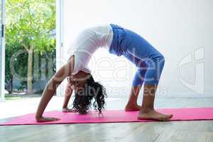 Portrait of girl bending over backwards while exercising