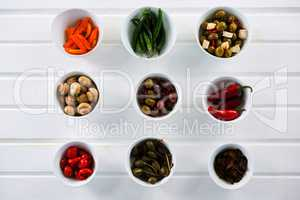 Marinated olives and vegetables on white background