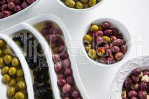 Pickled olives on white background