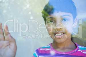 Close up portrait of girl seen through window