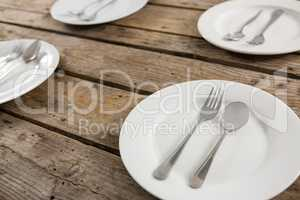 Close up of spoons and forks in plate