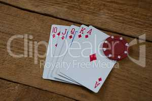 High angle view of cards and chip