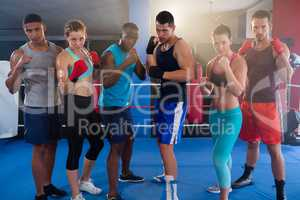 Portrait of confident young boxers ready to fight