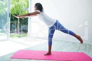 Girl exercising against wall