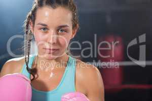 Close-up portrait of young female boxer
