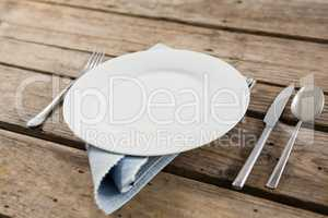 Close up of plate and cutlery with napkin