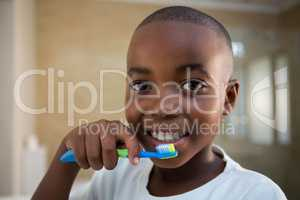 Close-up portrait of boy with toothbrush