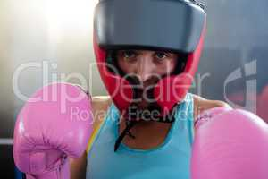 Close-up portrait of female boxer wearing protective headgear