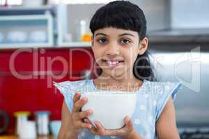 Portrait of smiling girl holding bowl