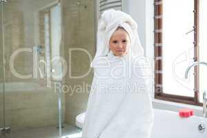 Portrait of girl sitting on bathtub