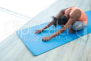 High angle view of girl exercising on exercise mat