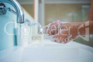Cropped image of girl washing hands