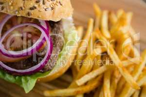 Onion in burger by French fries
