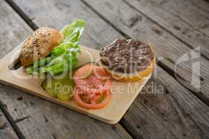 Vegetables and bun on cutting board