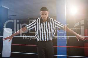 Male referee gesturing with arms outstretched