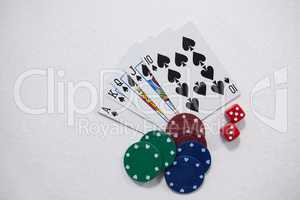 Playing cards, dice and casino chips on white background