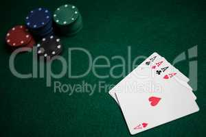Playing cards and casino chips on poker table