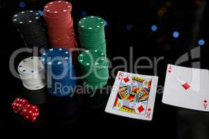 High angle view of cards and chips with dices