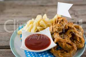 Onion rings with French fries